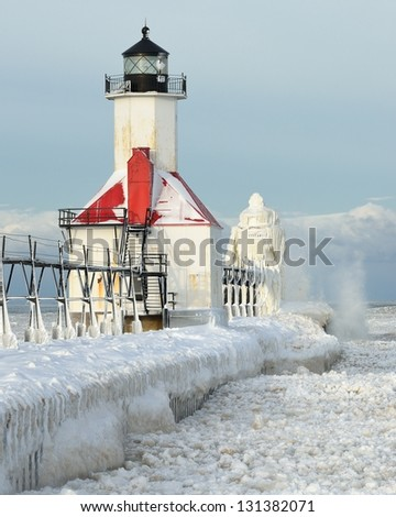 St. Joseph Lighthouse Lake Michigan Winter - stock photo