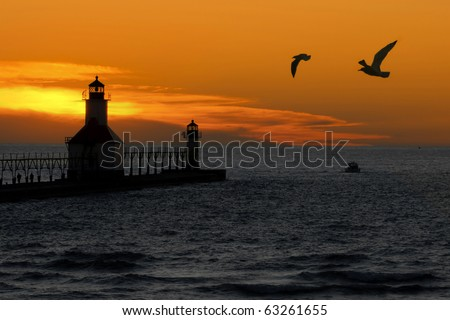 St. Joseph North Pier Lights in St. Joseph, Michigan at sunset. - stock photo