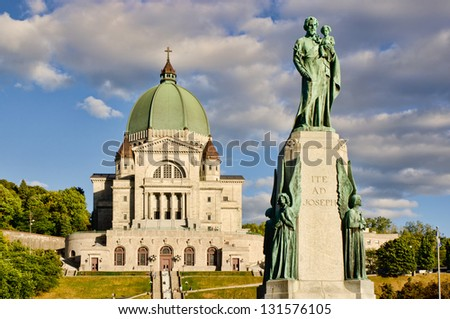 St.Joseph Oratory and St.Joseph monument, at sunset, with cloudy sky - stock photo