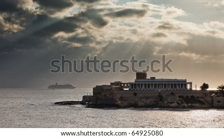St Julians, Malta with the casino and a cruise ship