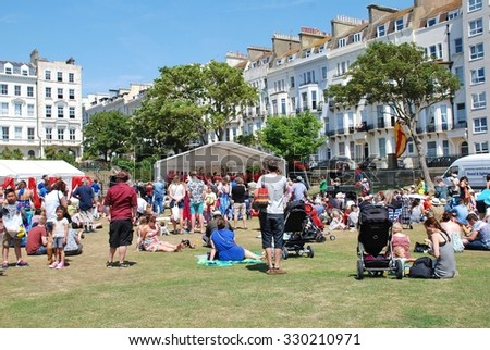 ST. LEONARDS-ON-SEA, ENGLAND - JULY 11, 2015: People enjoy the annual St.Leonards Festival held in Warrior Square Gardens. The free community music and entertainment event was first held in 2006. - stock photo