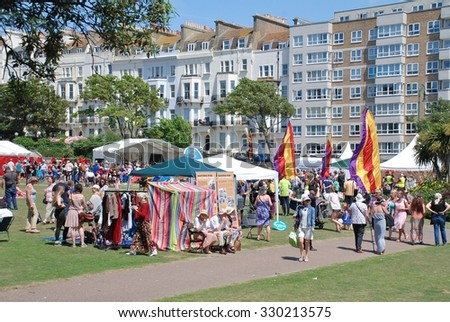 ST.LEONARDS-ON-SEA, ENGLAND - JULY 11, 2015: People enjoy the annual St.Leonards Festival held in Warrior Square Gardens. The free community music and entertainment event was first held in 2006.