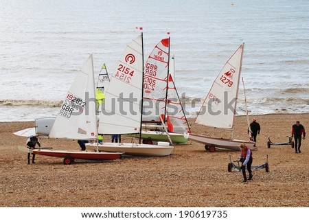 ST.LEONARDS-ON-SEA, ENGLAND - MARCH 23, 2014: Sailing dinghies of the Hastings and St.Leonards Sailing Club ready for launch from the shingle beach. The present day club was founded in 1953.  - stock photo