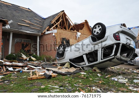 ST. LOUIS - APRIL 25, 2011: Cars and homes were heavily damaged by a tornado that swept through Maryland Heights in the suburbs of St. Louis on Good Friday, April 22, 2011. - stock photo