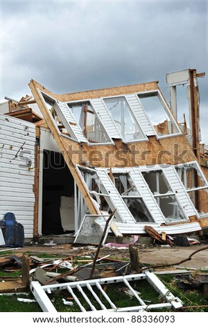 ST. LOUIS - APRIL 25: Heavily damaged cars and homes are seen on April 25, 2011 in St. Louis, MO. They were heavily damaged by a tornado that swept through the Maryland Heights are in the suburbs of St. Louis on Good Friday, April 22, 2011. - stock photo
