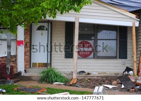 ST. LOUIS-APRIL 24: Homes display DO NOT ENTER signs warning residents that their homes are in an unsafe condition from tornados in St. Louis on Good Friday, April 24, 2011.