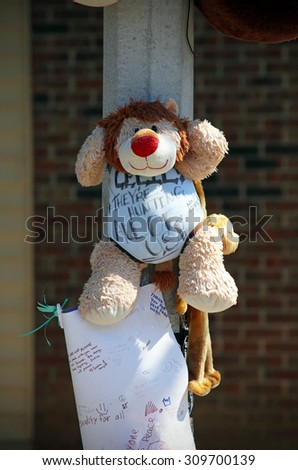 ST.LOUIS - AUGUST 21: A makeshift memorial for Michael Brown in St. Louis, Missouri on August 21 2015. In a controversial event, Mr. Brown was killed by police officer Darren Wilson after a struggle. - stock photo