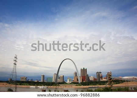 ST. LOUIS, MISSOURI - SEPTEMBER 26: View of St. Louis and the historic Gateway Arch in Missouri, from across the Mississippi River in Illinois, on September 26, 2009. The Arch is 630 feet high. - stock photo