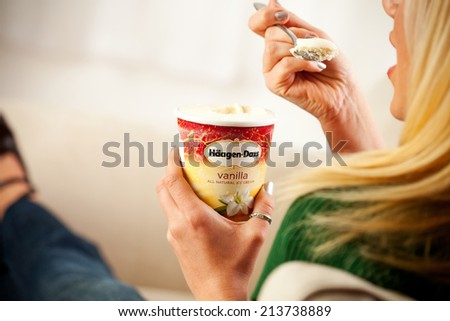 St. Louis, Missouri, USA - March 9, 2011: Woman Eating Pint Of Haagen-Dazs Vanilla Ice Cream