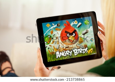 St. Louis, Missouri, USA - March 9, 2011: Woman Playing Angry Birds Video Game On Apple iPad 1 - stock photo