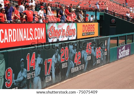 ST. LOUIS - SEPTEMBER 18: Cardinals fans and retired player numbers at Busch Stadium on September 18, 2010 in St. Louis. 11 Cardinal greats have had their numbers retired. - stock photo