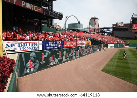 ST. LOUIS - SEPTEMBER 18: Cardinals fans vie for batting practice home run baseballs before a National League game at Busch Stadium against the San Diego Padres on September 18, 2010 in St. Louis. - stock photo