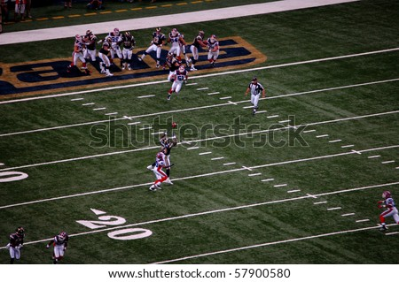 ST. LOUIS - SEPTEMBER 28: Randy McMichael of the Rams makes a catch over Donte Whitner of the Bills in a game at Edward Jones Dome September 28, 2008 in St. Louis, MO - stock photo