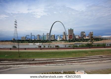 St. Louis Skyline - Gateway Arch and Railroad Tracks - stock photo