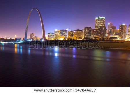 St. Louis skyline in the evening with the Arch in view - stock photo