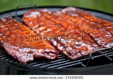 St Louis style BBQ ribs glazed in sauce - stock photo