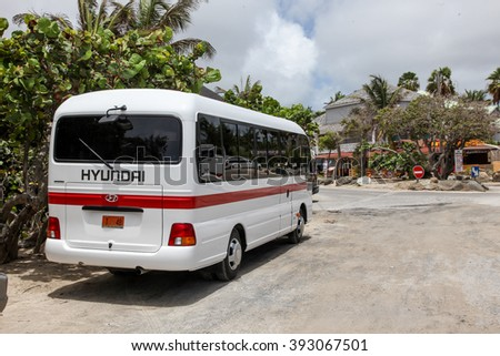 ST.MAARTEN, CARRIBEAN - AUGUST 2: Hyundai bus standing near Bikini beach entrance on Orient Bay (Baie Orientale) area  in Sint Maarten inAugust 2, 2015 in St.Maarten, Caribbean Island. - stock photo