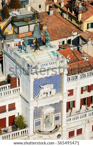 St Mark's Clocktower with Winged Lion, Bell and Madonna with Child. A view from the Campanile tower at Piazza San Marco in Venice (Italy).  - stock photo
