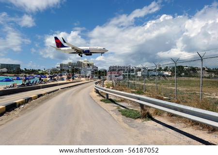 ST MARTIN - JUNE 26: Delta expansion gives more places to choose in the Caribbean. New destinations are Georgetown, Grand Cayman, Grenada. Here is new 73W about to land at St Martin on June 26, 2010. - stock photo