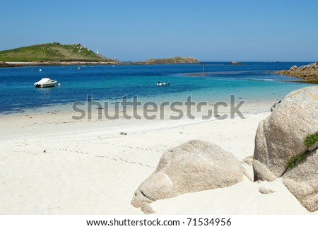 St. Martin's Lower Town beach and quay, Isles of Scilly. - stock photo