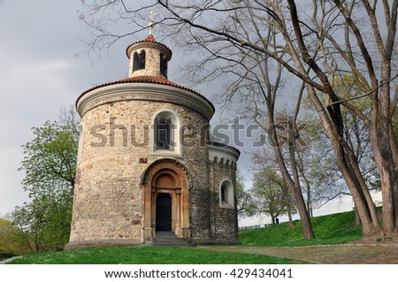 St. Martin's Rotunda at Vysehrad, Prague. Round old church against the thunderous sky. - stock photo