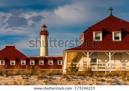 St. Mary by the Sea and the Cape May Point Lighthouse, in Cape May, New Jersey. - stock photo