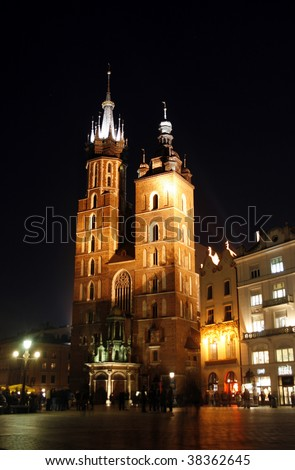 St. Mary's Basilica - famous brick gothic church in Cracow at night - stock photo