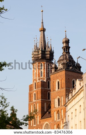 St. Mary's Basilica is a Brick Gothic church re-built in the 14th century (originally built in the early 13th century), adjacent to the Main Market Square in Kraków, Poland. - stock photo