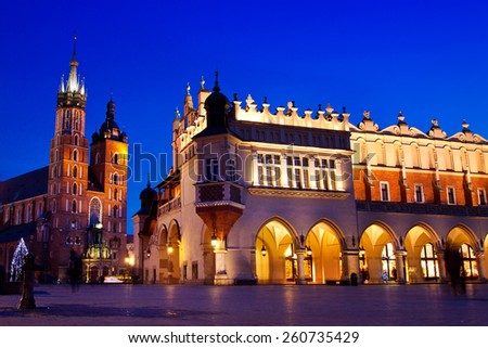 St. Mary's church and Sukiennice in Krakow at night - stock photo