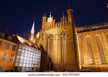 St. Mary's Church (Polish: Bazylika Mariacka) in Gdansk, Poland at night, Old Town city landmark - stock photo