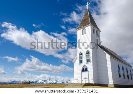 St. Mary's historic church in the foothills of the Rocky Mountains in Alberta, Canada  - stock photo