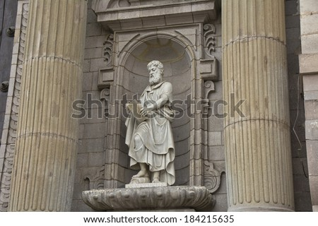 St. Matheus statue on the cathedral of Lima, Peru - stock photo