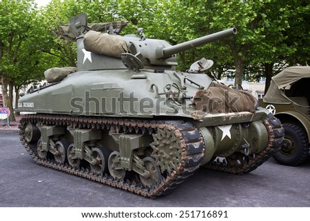 ST MERE EGLISE, FRANCE - JUNE 3: A vintage WW2 allied army Sherman tank is put on public display in the town square as part of the 70th D-Day anniversary celebrations on June 3, 2014 in St Mere Eglise - stock photo