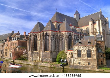 St Michael church on the side of a river in Ghent, Belgium - stock photo