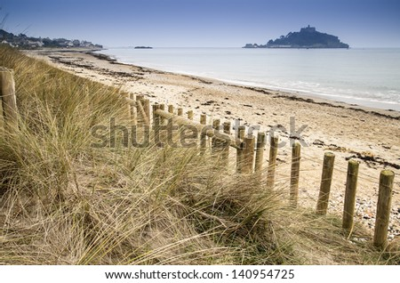 St Michael's Mount Bay Marazion landscape viewed through sand dunes Cornwall England - stock photo