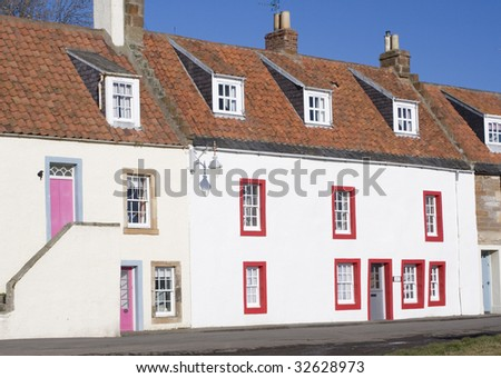 St Monan's colourful cottages along the seafront. - stock photo
