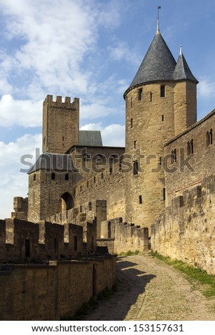 St. Nazaire Gate in the medieval fortress and walled citadel of Carcassonne in the Languedoc-Roussillon region of southwest France.  it was restored in 1853 and is now a UNESCO World Heritage Site. - stock photo