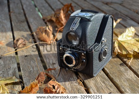 ST NEOTS, CAMBRIDGESHIRE, ENGLAND - OCTOBER 20, 2015: Vintage Ensign Twin lens Camera on rustic table with autumn leaves.