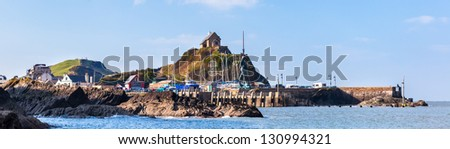 St Nicholas Chapel at the entrance to Ilfracombe Harbour Devon England UK - stock photo