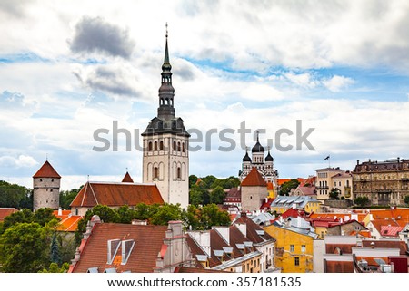 St. Nicholas Church and red roofs in Tallinn, Estonia. - stock photo