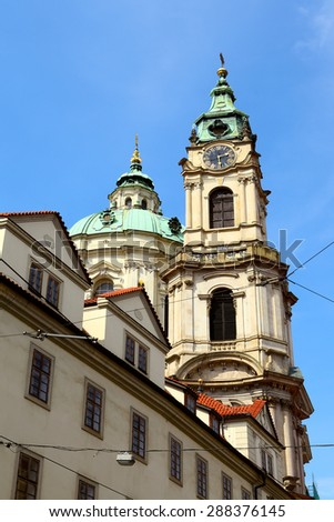 St.Nicholas Church in the quarter of Mala Strana in Prague (Czech Republic) - stock photo