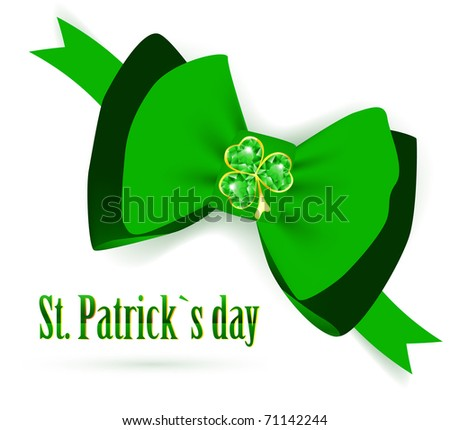 St.Patrick holiday green bow with emerald shamrock over white background - stock photo