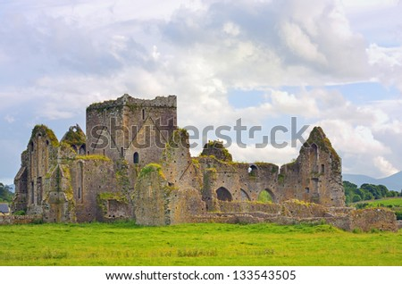 St. Patrick's Cathedral and green grass in Dublin, Ireland - stock photo