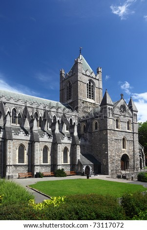 St. Patrick's Cathedral and green grass in Dublin, Ireland, vertical - stock photo
