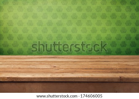 St.Patrick's day background with empty wooden table and wallpaper - stock photo