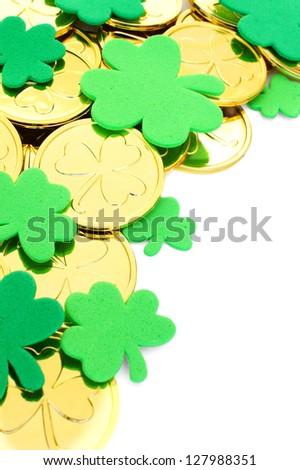 St Patrick's Day corner border of shamrocks and gold coins - stock photo