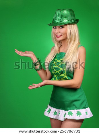 St Patrick's day Girl. Cheerful beautiful blonde young woman  - stock photo