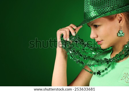 St Patrick's day Girl. Young woman wearing hat over green background