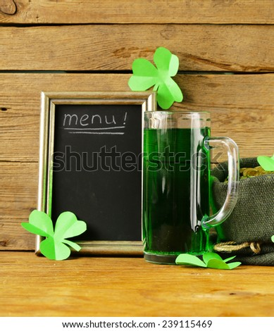St Patrick's Day green beer with shamrock  - stock photo
