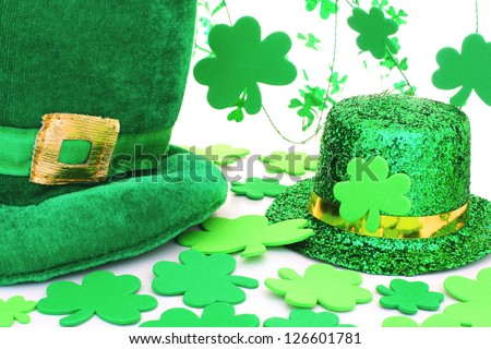 St Patrick's Day hats with shamrocks over white - stock photo